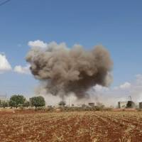 Smoke billows following Syrian government forces' bombardment around the village of al-Muntar on the southern edges of the rebel-held Idlib province on Saturday. Russian airstrikes on Syria's last major rebel bastion were the 'most violent' in a month since Damascus and its ally Moscow started threatening it with an imminent attack around a month ago, a monitor said. | AFP-JIJI