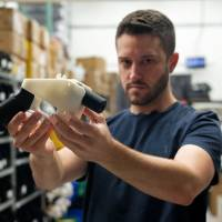 Cody Wilson, owner of Defense Distributed, holds a 3D printed gun, the 'Liberator,' in his factory in Austin, Texas, on Aug. 1. | AFP-JIJI