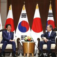 Kim is ready to engage in dialogue with Japan at appropriate time, Moon tells Abe