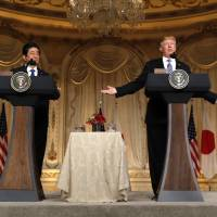 U.S. President Donald Trump (right) speaks as he hosts a joint press conference with Prime Minister Shinzo Abe at Trump's Mar-a-Lago estate in Palm Beach, Florida, in April. | REUTERS
