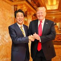 Shinzo Abe poses with U.S. President Donald Trump in this photo posted to the prime minister's official Facebook account Sunday. Abe met Trump for dinner and said they had a constructive talk.