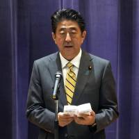 Prime Minister Shinzo Abe delivers a speech during the Self-Defense Forces senior officers' gathering at Defense Ministry in Tokyo on Monday. Abe is planning to ask Chinese President Xi Jinping to ease Beijing's ban on importing some Japanese foods that followed the 2011 nuclear crisis. | AP