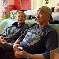 Yasuhiro Watanabe, 56, and his wife, Evelin, 53, speak during an interview Tuesday at their home in the town of Abira, Hokkaido. The house they have shared for 22 years suffered damage from the powerful earthquake that hit the prefecture a week ago. | SATOKO KAWASAKI