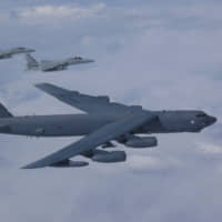A U.S. Air Force B-52 bomber and two Air Self-Defense Force F-15 fighters execute a routine bilateral training mission over the East China Sea and the Sea of Japan on Thursday. | U.S. PACIFIC AIR FORCES