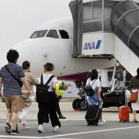 As Kansai airport partially reopens, officials discuss temporarily routing some flights elsewhere