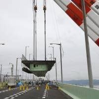 Work begins on repairing Kansai airport's bridge with an aim of restarting rail services by end of month