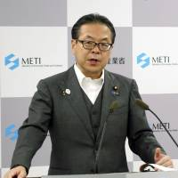 Industry minister Hiroshige Seko speaks at a news conference in Tokyo on Tuesday. | KYODO