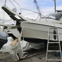 The badly damaged bow of a boat is seen after it slammed into a quay on Mukaishima Island in Hiroshima Prefecture on Sunday morning. Seven people were injured in the accident. | KYODO
