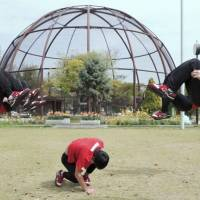 A screenshot of a YouTube video released by the Kurume Municipal Government in Fukuoka Prefecture shows the dance group Kyushudanji Shinsengumi showing off their moves at the Kurume Bird Center. | KYODO