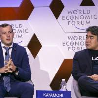 Mike Kayamori (right), CEO of Quoine Pte. Ltd., a Tokyo-based firm that runs a bitcoin exchange, attends a session on cryptocurrency as a panelist during the World Economic Forum's Annual Meeting of the New Champions on Sept. 18 in Tianjin, China. | WORLD ECONOMIC FORUM