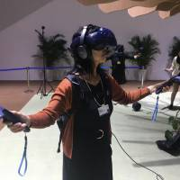 A virtual reality film where users experience becoming a tree is showcased at the World Economic Forum's Annual Meeting of the New Champions in Tianjin, China, on Sept. 18. | THE JAPAN TIMES