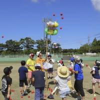 Children play a ball game during a summer camp for children with diabetes held in Daisen, Tottori Prefecture, in August. | KYODO