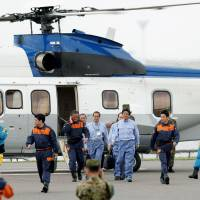 Prime Minister Shinzo Abe (third from right) visits Kawasaki on Saturday to observe a disaster drill conducted by the Tokyo Metropolitan Government and other prefectures and municipalities. | KYODO
