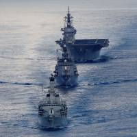 The British frigate HMS Argyll (front), Japanese destroyer Inazuma (center) and Japanese helicopter carrier Kaga take part in a joint naval drill in the Indian Ocean on Wednesday. | REUTERS
