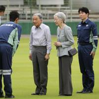 Emperor Akihito and Empress Michiko are seen after their arrival at a park in Kurashiki, Okayama Prefecture, on Friday. During their visit they met victims of July's deadly downpours in western Japan. | POOL / VIA KYODO