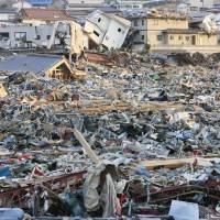 The town of Onagawa, Miyagi Prefecture, is seen on March 13, 2011, two days after a massive earthquake triggered tsunami.   KYODO