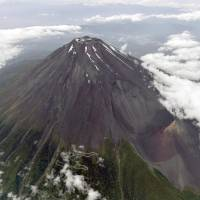Mount Fuji, seen in this photo taken in June, is an active volcano with a history of a number of major eruptions. | KYODO