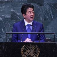 Prime Minister Shinzo Abe speaks at the U.N. General Assembly in New York on Tuesday. | AFP-JIJI