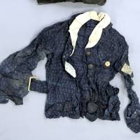The school uniform and hood of student Yoko Moriwaki, passed on to her family by staff from her school after she died on the night of Aug. 6, 1945, when the atomic bomb was dropped on Hiroshima, were donated by her brother Koji Hosokawa to the Hiroshima Peace Memorial Museum. | CHUGOKU SHIMBUN