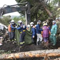 Rescue workers search for missing people at the site of a landslide in the town of Atsuma, Hokkaido, on Friday morning, a day after a major earthquake hit the region. | KYODO