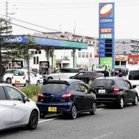 Drivers queue in front of a gas station in Tomakomai, Hokkaido, on Friday morning, a day after a powerful earthquake hit the region. | KYODO