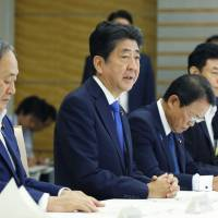 Prime Minister Shinzo Abe speaks at a government meeting on natural disasters at the Prime Minister's Office on Friday. | KYODO