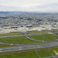 Kansai International Airport recovered from Typhoon Jebi rather quickly, but regional leaders want Kobe airport and Itami airport (shown here) to be able to offer international flights should another disaster strike.   KYODO