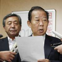 LDP Secretary-General Toshihiro Nikai speaks to reporters Thursday at the party's headquarters in Tokyo. | KYODO