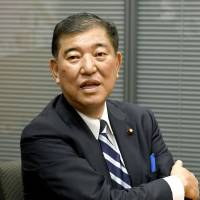 Shigeru Ishiba speaks to reporters in the Diet building on Friday. | KYODO