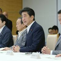 Prime Minister Shinzo Abe speaks during a Cabinet meeting on Thursday. The latest Kyodo News poll showed 61 percent of voters with membership in the ruling Liberal Democratic Party said they will vote for Abe in the Sept. 20 LDP presidential election. | AFP-JIJI