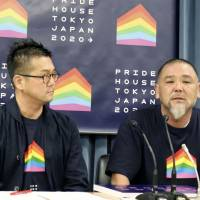 Gon Matsunaka (left), who represents the Pride House Tokyo consortium, speaks at a joint news conference with artist Asao Tokolo and others on Thursday in Tokyo. | KYODO