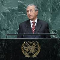 Malaysian Prime Minister Mahathir Mohamad addresses the 73rd session of the United Nations General Assembly at U.N. headquarters in New York on Friday. | REUTERS