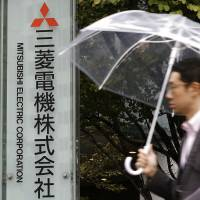 Labor authorities have recognized that four Mitsubishi Electric Corp. employees suffered mental and physical illnesses due to overwork, two of whom committed suicide. | KYODO