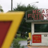 A gate at U.S. Marine Corps Air Station Futenma in Ginowan, Okinawa Prefecture, is shown in December 2006. | BLOOMBERG