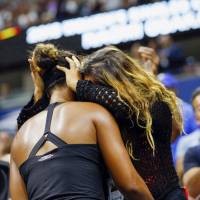 Naomi Osaka is congratulated by her mother, Tamaki, on Sept. 8 in New York after winning the singles title at the U.S. Open. | KYODO