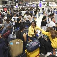 Narita airport's automated check-in system back online a day after glitch