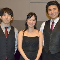 The members of the Aoi Trio, the first piano trio from Japan to win first prize in the prestigious ARD International Music Competition, are seen in Munich on Saturday. From left: cellist Yu Ito, violinist Kyoko Ogawa and pianist Kosuke Akimoto. | KYODO