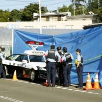 Police officers gather at a police box in Sendai where an officer was stabbed to death by a man Wednesday. | KYODO