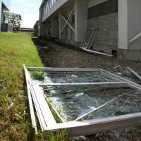 A window frame that fell from the gymnasium at Eniwaminami High School in the city of Eniwa, Hokkaido, during the Sept. 6 earthquake is seen Tuesday. | KYODO
