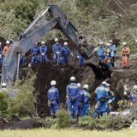 Rescuers are seen Saturday continuing their search in Atsumi for any survivors from the magnitude 6.7 quake that rocked southern Hokkaido in the small hours of Thursday. | KYODO