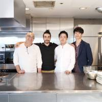 Nazem Jamal Alddin (left), his son, Yasser (second from left), Tomoki Morikawa (second from right) and Hokuto Sasaki, manager of the Syrian pop-up restaurant venue, pose for a photo at the establishment in Tokyo's Minato Ward on Sept. 5. | CHISATO TANAKA