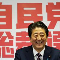 Prime Minister Shinzo Abe gives a news conference after winning the Liberal Democratic Party's leadership vote at the party's headquarters in Tokyo on Thursday. | REUTERS