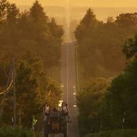 A truck drives on what has been dubbed the 'Road to Heaven,' which is becoming a new tourist destination in the Hokkaido town of Shari. | KYODO