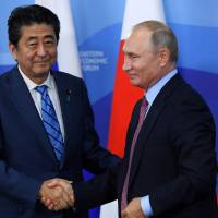 Prime Minister Shinzo Abe and Russian President Vladimir Putin wrap up a news conference after their meeting in Vladivostok, Russia, on Monday.   AFP-JIJI