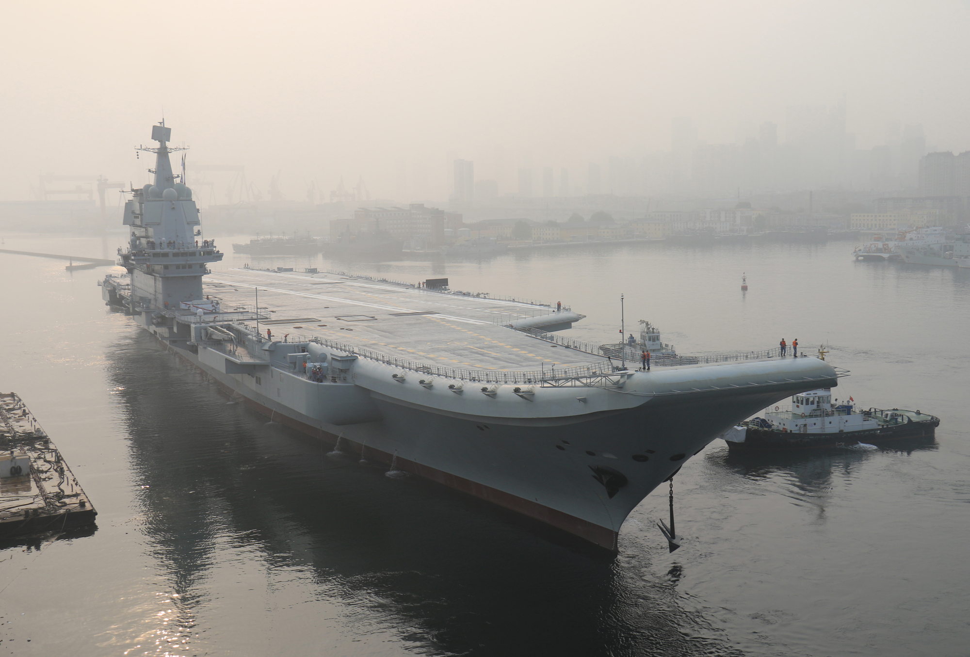 China's first domestically made aircraft carrier lifts anchor in Dalian, Liaoning province, on May 13. | AP