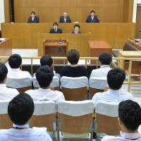 The Naha branch of the Fukuoka High Court on Thursday upheld a lower court's ruling that sentenced Kenneth Franklin Shinzato, a former U.S. military base worker, to life in prison. | POOL / VIA KYODO