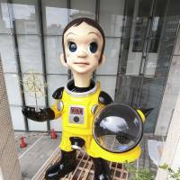 Controversial Fukushima statue of child in radiation suit now being removed