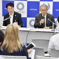 Tokyo 2020 Vice Director-General Yusuke Sakaue (right) speaks to reporters about soliciting volunteers Wednesday at the Tokyo Metropolitan Government's office. | POOL / VIA KYODO