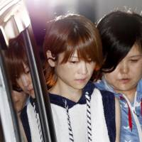 Hitomi Yoshizawa is seen in front of Nakano Police Station on Thursday after being arrested for an alleged hit-and-run incident involving drunken driving. | KYODO