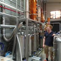 Alex Davies, head distiller of Kyoto Distillery, inspects his work in August. | ERIC JOHNSTON